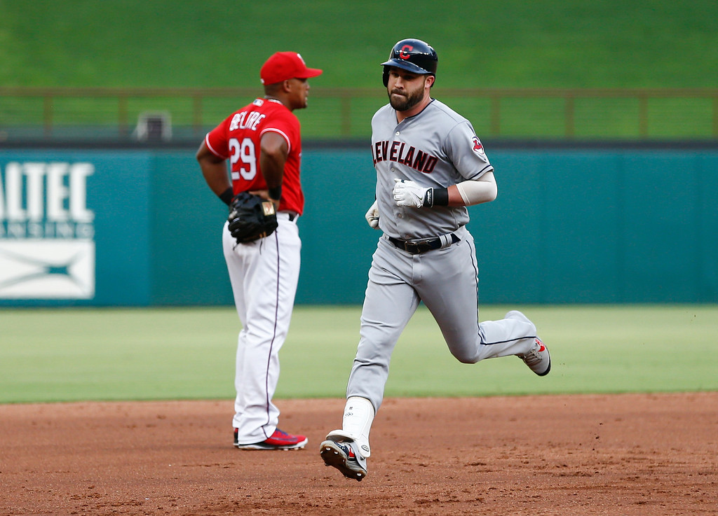 . Cleveland Indians\' Jason Kipnis, right, circles the bases on his two-run home run past Texas Rangers third baseman Adrian Beltre, left, during the second inning of a baseball game, Friday, July 20, 2018, in Arlington, Texas. (AP Photo/Jim Cowsert)