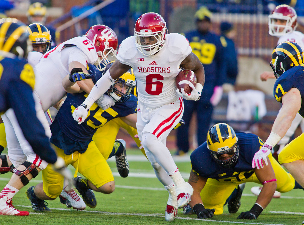 . Indiana running back Tevin Coleman (6) rushes through Michigan defenders in the third quarter of an NCAA college football game in Ann Arbor, Mich., Saturday, Nov. 1, 2014. Michigan won 34-10. (AP Photo/Tony Ding)