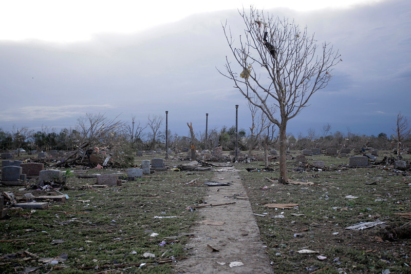 . Debris lies around Moore Cemetery after it was damaged by a tornado May 21, 2013 in Moore, Oklahoma. The town reported a tornado of at least EF4 strength and two miles wide that touched down yesterday killing at least 24 people and leveling everything in its path. U.S. President Barack Obama promised federal aid to supplement state and local recovery efforts.  (Photo by Brett Deering/Getty Images)