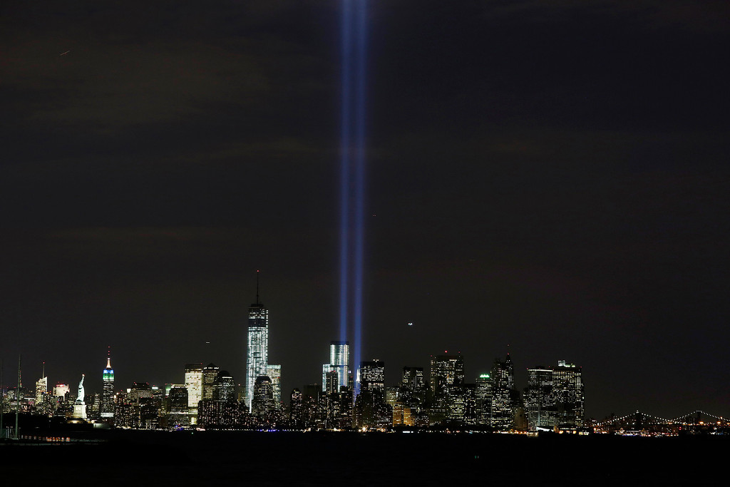 . CORRECTS YEAR OF TERROR ATTACKS TO 2001, INSTEAD OF 2011 - The Tribute in Light rises above the lower Manhattan skyline and One World Trade Center, left, in a test of the memorial light display, Monday, Sept. 9, 2013 in New York. The twin beams of light will also appear Wednesday, Sept. 11, twelve years after the terrorist attacks of Sept. 11, 2001. (AP Photo/Mark Lennihan)