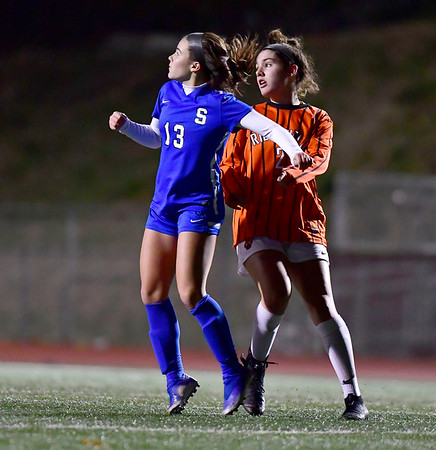 11/19/2019 Mike Orazzi | Staff Southington High School's Maya Wroblewski (13) and Ridgefield High School's JEva McKinley (2) during the Class LL Semifinal Girls Soccer match at Naugatuck High School Tuesday night. Southington advanced to the final 1-0.