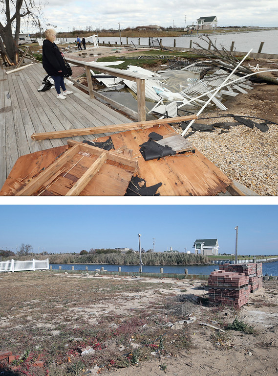 . AMITY HARBOR, NY - OCTOBER 31: (top) Resident Pat Lore checks out the damage caused to her home from Hurricane Sandy on the Western Concourse on October 31, 2012 in Amity Harbor, New York. AMITY HARBOR, NY - OCTOBER 22: (bottom) The backyard of a home sits empty almost one year after sustaining damage from Superstorm Sandy on October 22, 2013 in Amity Harbor, New York. Hurricane Sandy made landfall on October 29, 2012 near Brigantine, New Jersey and affected 24 states from Florida to Maine and cost the country an estimated $65 billion. (Photos by Bruce Bennett/Getty Images)