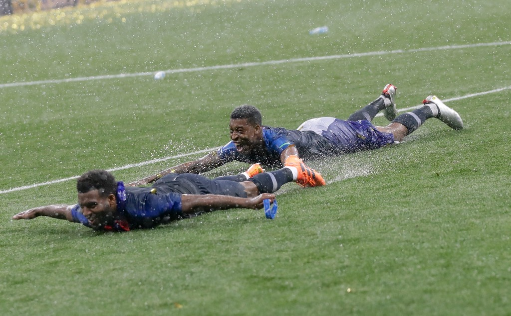. France\'s Samuel Umtiti, left, celebrates at the end of the final match between France and Croatia at the 2018 soccer World Cup in the Luzhniki Stadium in Moscow, Russia, Sunday, July 15, 2018. France won 4-2. (AP Photo/Petr David Josek)