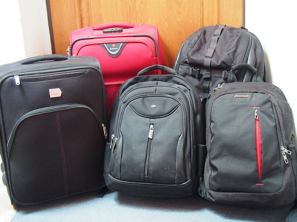 Travel backpack and wheeled suitcases.