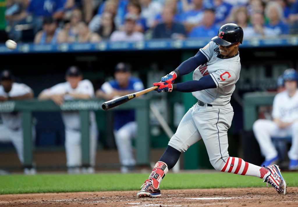 . Cleveland Indians\' Francisco Lindor hits a grand slam off Kansas City Royals starting pitcher Jakob Junis during the fourth inning of a baseball game at Kauffman Stadium in Kansas City, Mo., Monday, July 2, 2018. (AP Photo/Orlin Wagner)