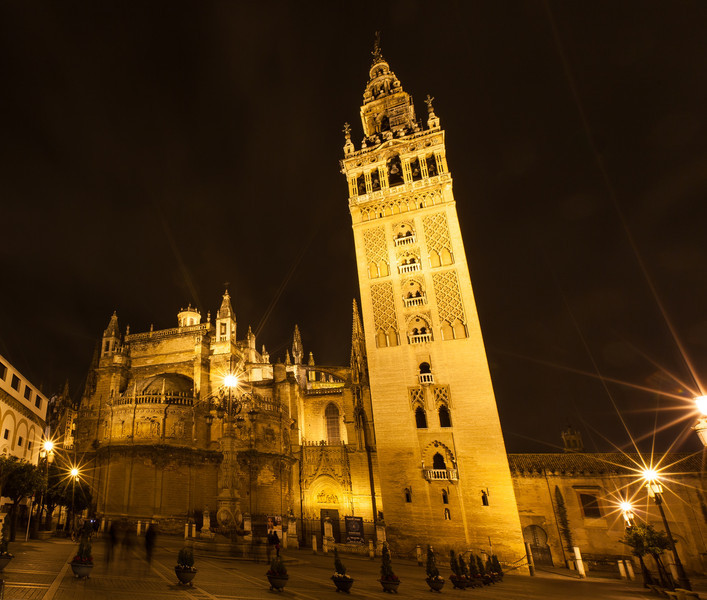 Seville cathedral and square at night.