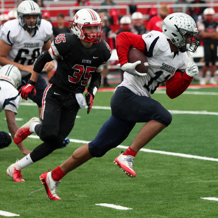 . Randy Meyers - The Morning Journal<br> Daylin Dower of Lorain breaks into the open for a big gain as Elyria\'s Ben Doehr gives chase during the second quarter on Sept. 8.