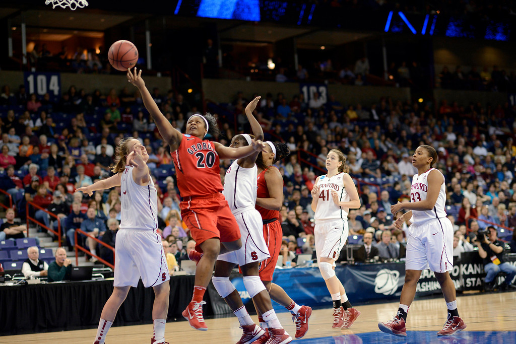 . Georgia\'s Shacobia Barbee (20) drives through Stanford\'s defense in the first half of a regional semifinal in the NCAA women\'s college basketball tournament, Saturday, March 30, 2013, in Spokane, Wash. (AP Photo/Jed Conklin)