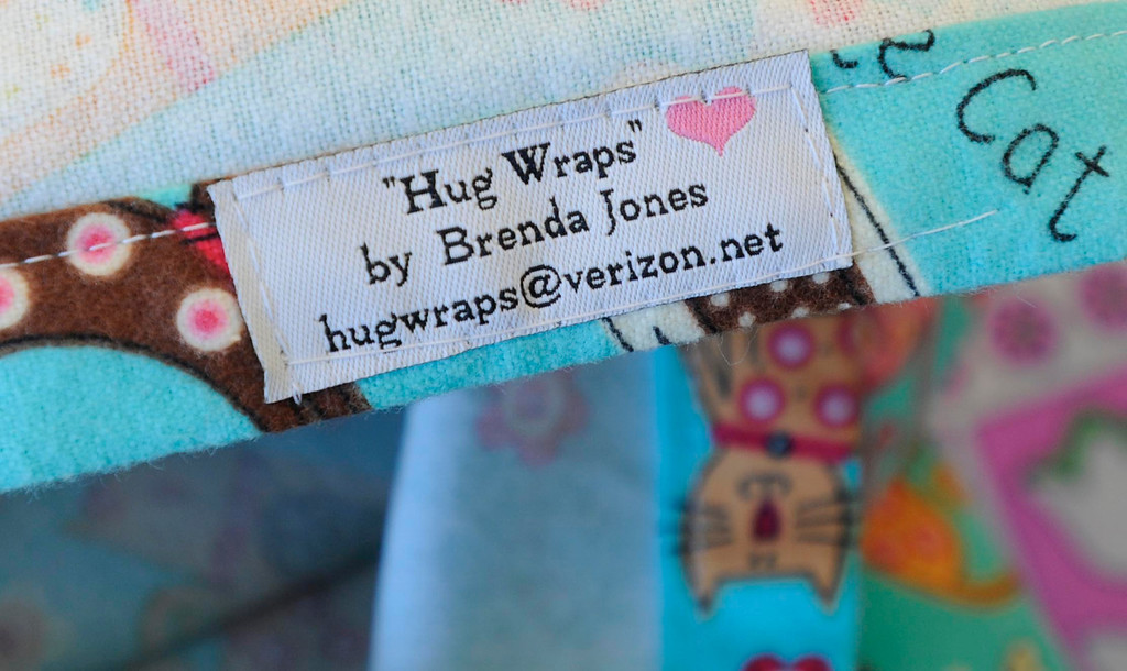 . Brenda Jones created her own open-in-the-front wrap when she was undergoing treatment for breast cancer, crafting an option to the hospital gown, utilizing soft and colorful flannel fabrics. Fellow patients loved them and her nonprofit Hug Wraps was born. Jones visited Providence Saint Joseph Medical Center�s Roy and Patricia Disney Family Cancer Center and gave patients free wraps. Burbank, CA 2/22/2013(John McCoy/Staff Photographer)