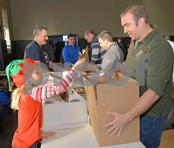 Volunteers pack boxes of food for 400 Berwyn families, at the Liberty Cultural Center