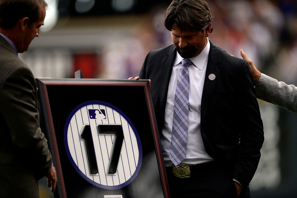 . Colorado Rockies great Todd Helton stands with a replica of his retired number 17 during a retirement ceremony held in his honor. Helton, who played 17 season with the Rockies and holds records for many of the organizations career statistics, was honored on Sunday, August 17, 2014. (Photo by AAron Ontiveroz/The Denver Post)