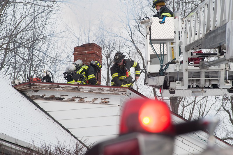 Westminster FFs work on a roof during a chimney fire on East Rd.