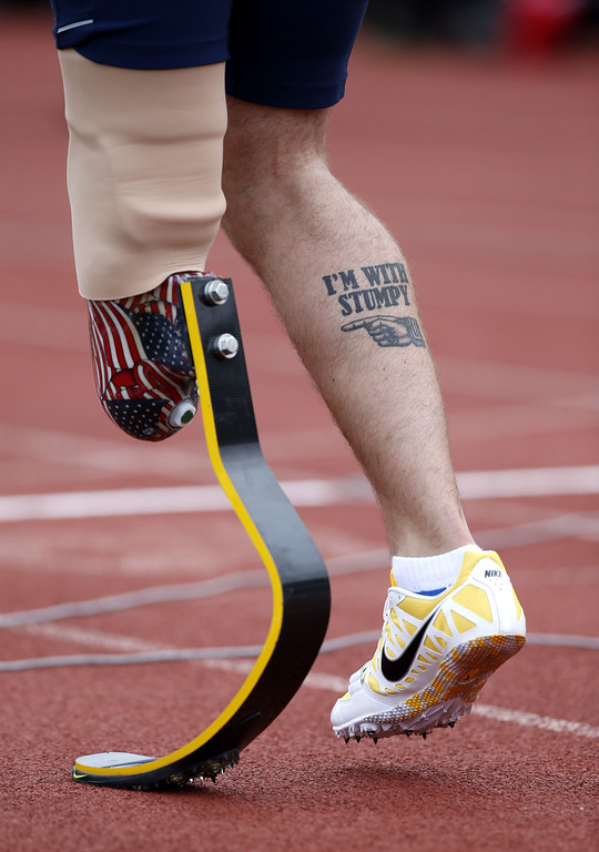 . Ramos Redmond of the US stands on the start line before competing in the 400m men ambulant IT1 during athletics event of the Invictus Games at Queen Elizabeth II Park in London on September 11, 2014.  AFP PHOTO/ADRIAN DENNISADRIAN DENNIS/AFP/Getty Images