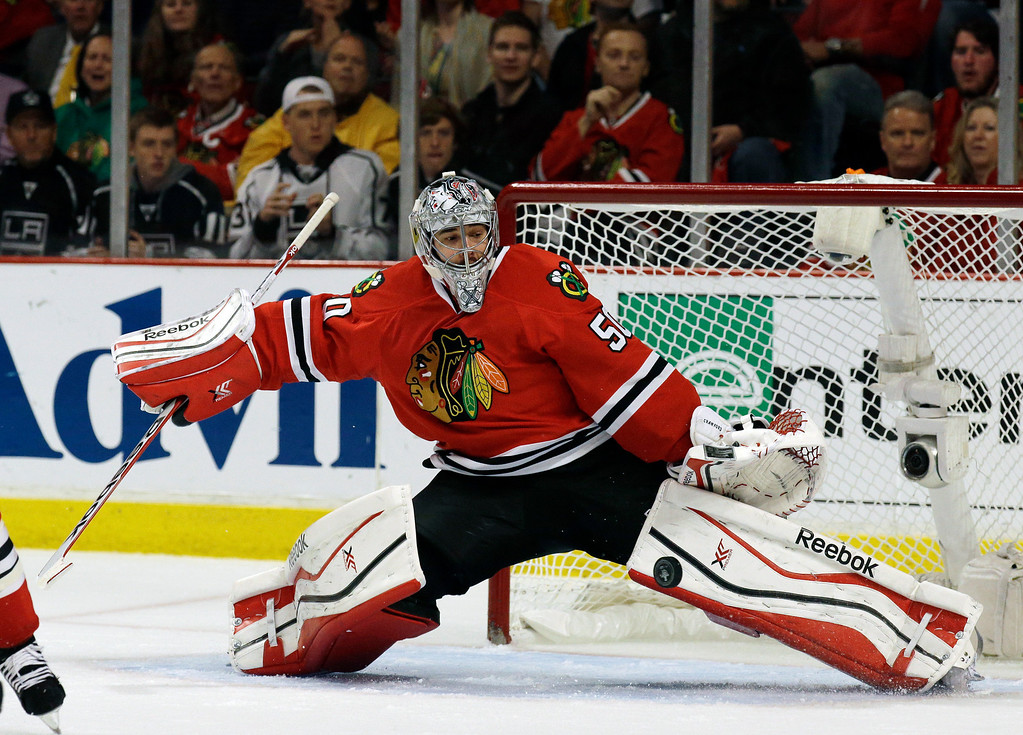 . Chicago Blackhawks goalie Corey Crawford gives up a goal by Los Angeles Kings right wing Marian Gaborik during the first period in Game 5 of the Western Conference finals in the NHL hockey Stanley Cup playoffs Wednesday, May 28, 2014, in Chicago. (AP Photo/Nam Y. Huh)