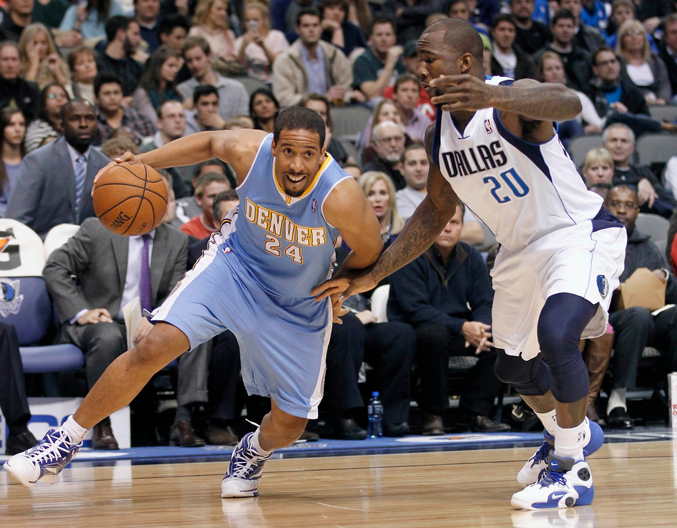 . Denver Nuggets guard Andre Miller (L) drives to the basket as Dallas Mavericks guard Dominique Jones defends during the second half of their NBA basketball game in Dallas, Texas December 28, 2012.  REUTERS/Mike Stone (UNITED STATES - Tags: SPORT BASKETBALL)