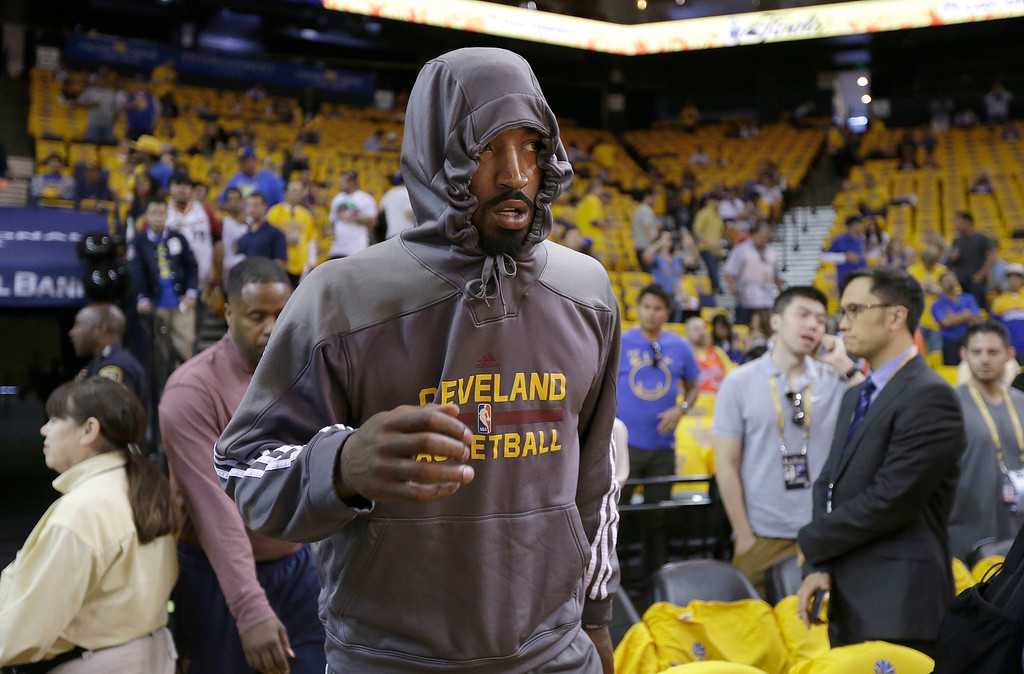 . Cleveland Cavaliers guard J.R. Smith walks on to the court before Game 1 of basketball\'s NBA Finals against the Golden State Warriors in Oakland, Calif., Thursday, June 4, 2015. (AP Photo/Ben Margot)