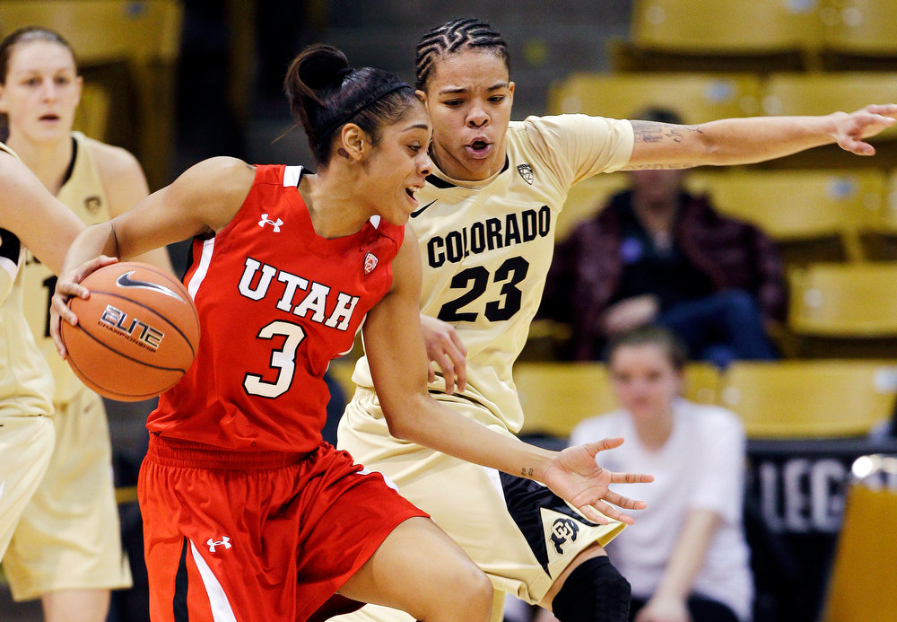 . Utah\'s Iwalani Rodrigues (3) drives to the basket against Colorado\'s Chucky Jeffery (23) during the second half of their NCAA college basketball game, Tuesday, Jan. 8, 2013, in Boulder, Colo. Colorado won 67-57. (AP Photo/Brennan Linsley)