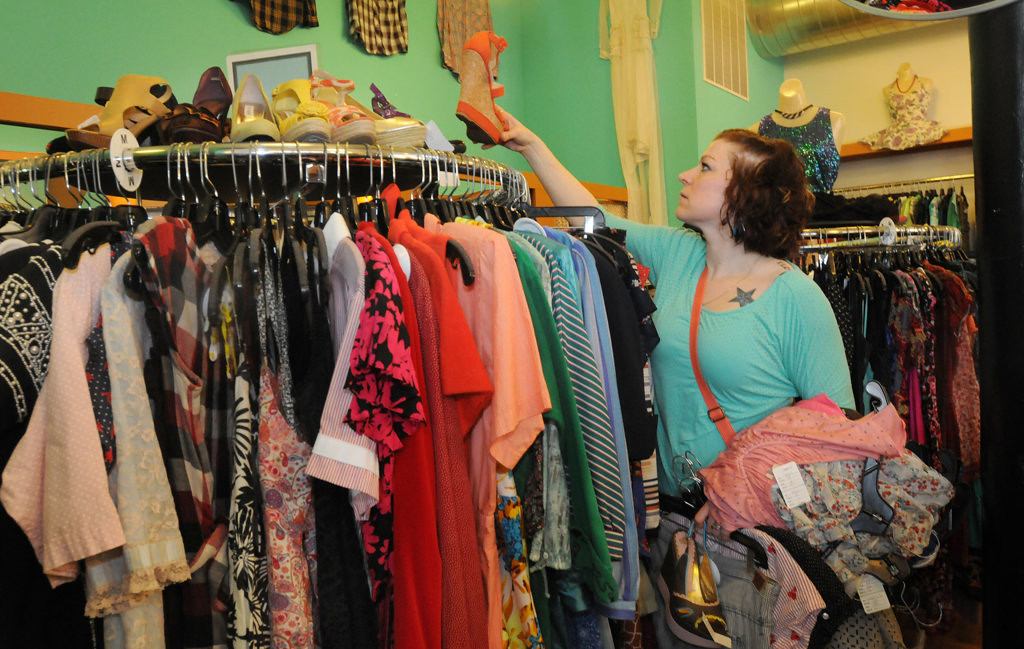 """. Kelly DeCosse of St. Paul visited Everyday People at 1599 Selby Ave in St. Paul on April 27, 2013. \""""I\'m into reduce, reuse, recycle. I think I\""""ll be coming here a lot she said, of the shop.\"""" (Pioneer Press: Ginger Pinson)"""