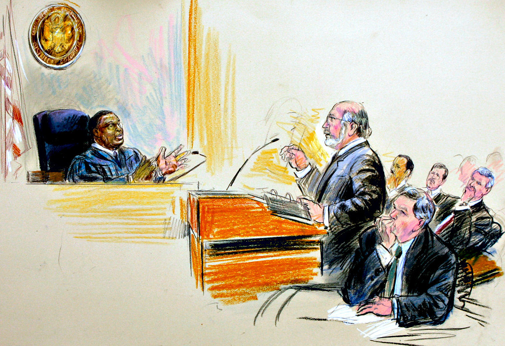 """. This artist rendering depicts U.S. District Judge Reggie B. Walton, left, hearing an argument on behalf of former White House aide I. Lewis \""""Scooter\"""" Libby by appellate attorney Lawrence S. Robbins, center, as Special Prosecutor Patrick Fitzgerald listens, bottom right with right hand to chin, in U.S. District Court in Washington, Thursday, June 14, 2007. At far right are depictions of Libby and his defense team; from right to left are: I. Lewis \""""Scooter\"""" Libby, attorney William Jeffress, and lead attorney Theodore Wells. (AP Photo/Dana Verkouteren)"""