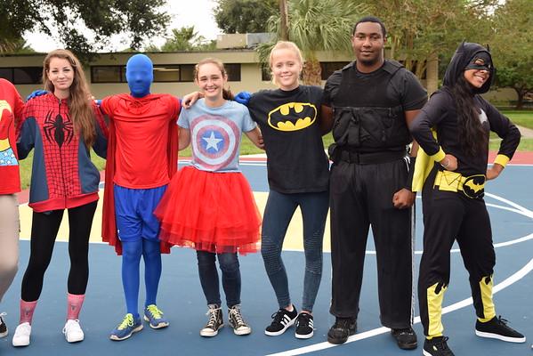 Upper School Super Heroes Read to Lower School Students