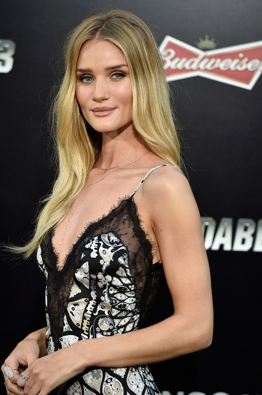 ". Model  Rosie Huntington-Whiteley arrives at the Premiere Of Lionsgate Films\' ""The Expendables 3\"" at TCL Chinese Theatre on August 11, 2014 in Hollywood, California.  (Photo by Frazer Harrison/Getty Images)"