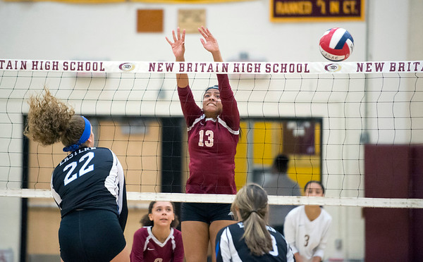 09/16/19 Wesley Bunnell | StaffrrNew Britain volleyball player Abria McDonald (13) goes to the net for a block attempt.
