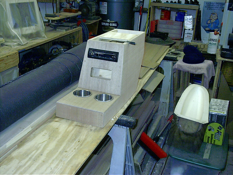 Starboard side view of console skinned in mahogany with stereo and drink holders installed.