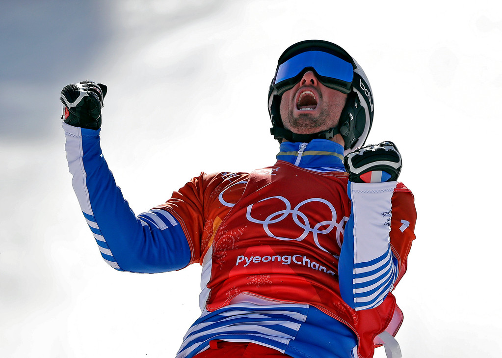 . Pierre Vaultier, of France, celebrates after winning gold during the men\'s snowboard cross final at Phoenix Snow Park at the 2018 Winter Olympics in Pyeongchang, South Korea, Thursday, Feb. 15, 2018. (AP Photo/Gregory Bull)