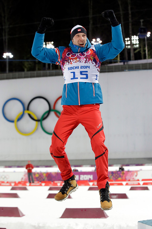 . Austria\'s Dominik Landertinger celebrates after clinching the silver medal in the men\'s biathlon 10k sprint, at the 2014 Winter Olympics, Saturday, Feb. 8, 2014, in Krasnaya Polyana, Russia. (AP Photo/Lee Jin-man)