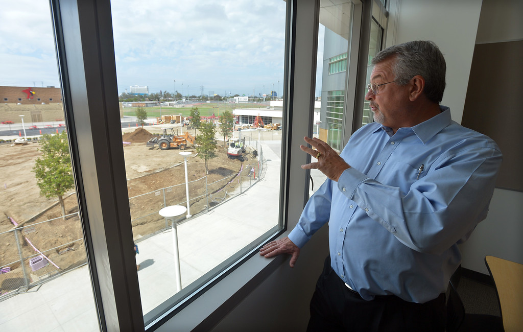 . John Clem, president of TELACU construction, looks over the quad area that is being finished at Lawndale High in Lawndale, CA on Tuesday, August 19, 2014. Lawndale and Leuzinger high schools begin Wednesday and students will be working in new buildings that were constructed with bond money. (Photo by Scott Varley, Daily Breeze)