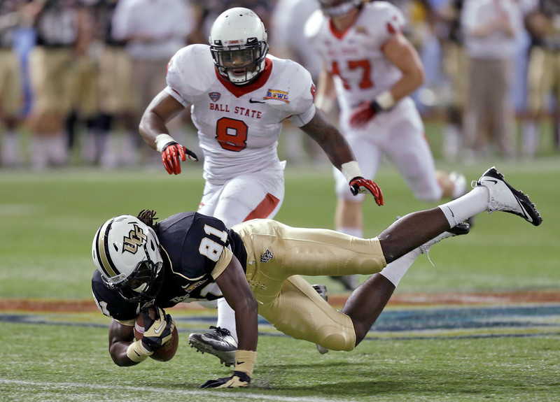. Central Florida wide receiver Breshad Perriman (81) is tripped up by Ball State linebacker Travis Freeman (8) after a reception during the first quarter of the Beef \'O\' Brady\'s Bowl NCAA college football game Friday, Dec. 21, 2012, in St Petersburg, Fla. (AP Photo/Chris O\'Meara)