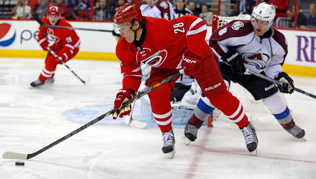 . Carolina Hurricanes\' Alexander Semin (28), of Russia, battles against Colorado Avalanche\'s Jan Hejda (8), of the Czech Republic, during the second period of an NHL hockey game in Raleigh, N.C., Tuesday, Nov. 12, 2013. (AP Photo/Karl B DeBlaker)