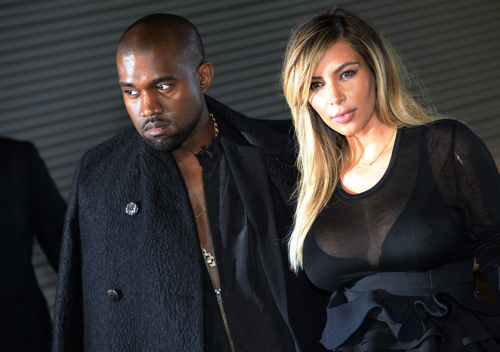 . US musician Kanye West and partner Kim Kardashian pose prior to Givenchy 2014 Spring/Summer ready-to-wear collection fashion show, on September 29, 2013 in Paris.    (PIERRE ANDRIEU/AFP/Getty Images)
