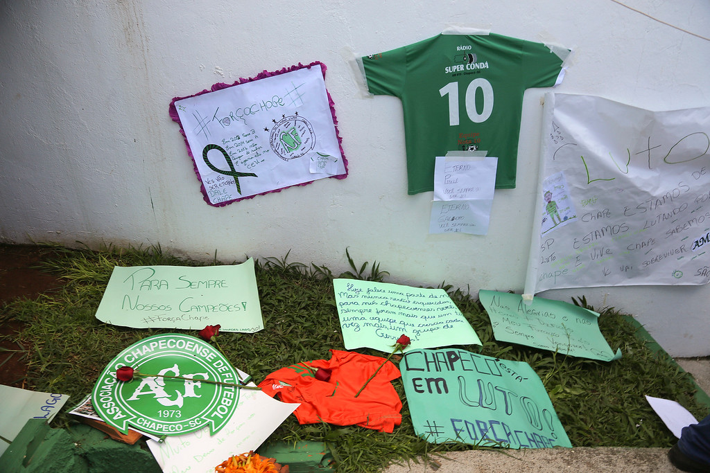 . Messages left by fans are part of a makeshift memorial for members of the Chapecoense soccer team outside the Arena Conda stadium in Chapeco, Brazil, Tuesday, Nov. 29, 2016. A chartered plane that was carrying the Brazilian soccer team to the biggest match of its history crashed into a Colombian hillside and broke into pieces, Colombian officials said Tuesday. (AP Photo/Andre Penner)