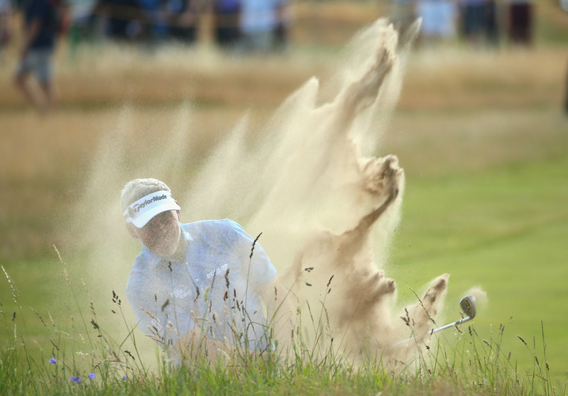. Darren Clarke of Northern Ireland hits from a bunker on the 5th hole during the first round of The 143rd Open Championship at Royal Liverpool on July 17, 2014 in Hoylake, England.  (Photo by Mike Ehrmann/Getty Images)