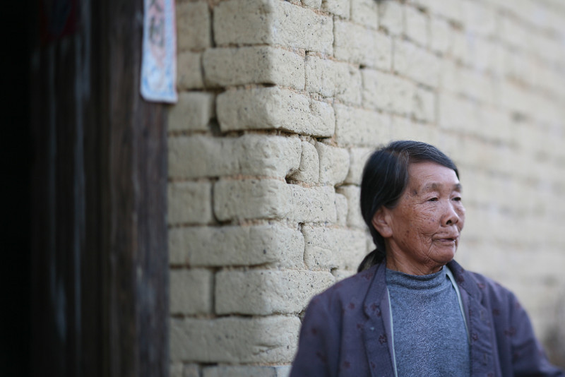 Woman, Taking a Break from Spinning Cotton, Yang Shuo, China