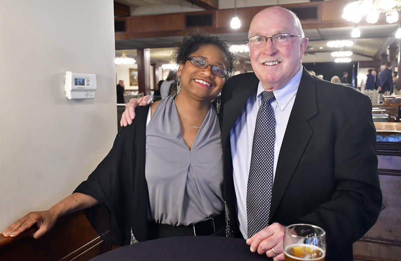 4/25/2019 Mike Orazzi | Staff 2019 Employee of the Year award recipient  Missy Cipriano of Bread for Life with Michael Baker  during the Southington Chamber of Commerce's 81st Annual Dinner held at the Aqua Turf Club in Southington Thursday evening.