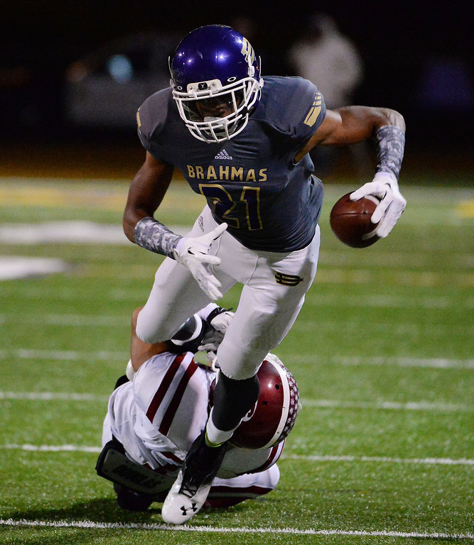 . Diamond Bar\'s Cordell Broadus (21) runs for yardage against La Serna in the first half of a CIF-SS playoff football game at Diamond Bar High School in Diamond Bar, Calif., on Friday, Nov. 22, 2013.   (Keith Birmingham Pasadena Star-News)