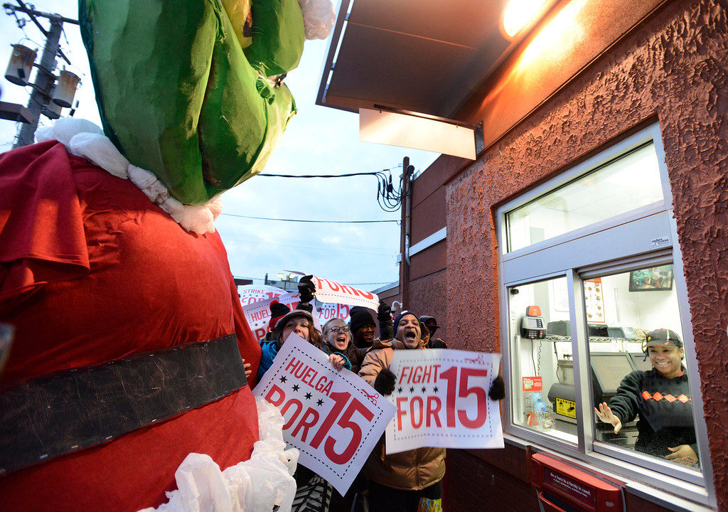 . Demonstrators rally for better wages outside a McDonald\'s restaurant in Chicago, Thursday, Dec., 5, 2013. (AP Photo/Paul Beaty)