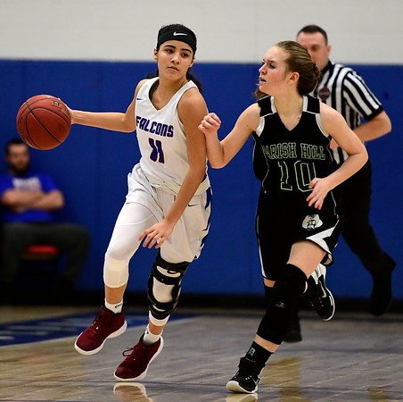 2/28/2019 Mike Orazzi | Staff St. Paul Girls Basketball's Janessa Gonzalez (11) and Parish Hill's Rajchel Smardon (10) during the Class S Second Round State Girls Basketball Tournament in Bristol Thursday night.