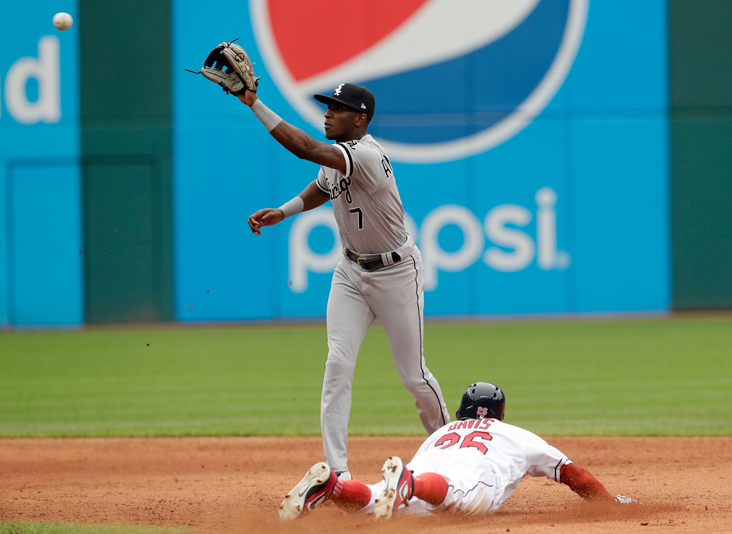 . Chicago White Sox\'s Tim Anderson waits for the ball as Cleveland Indians\' Rajai Davis steals to second base in the sixth inning of a baseball game, Wednesday, June 20, 2018, in Cleveland. Davis was safe at second base for the steal. (AP Photo/Tony Dejak)