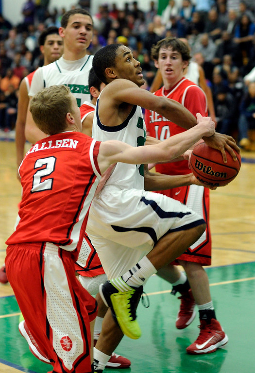 . Blazers guard Austin Conway (15) went to the basket in the second half. The Overland High School boy\'s basketball team defeated Regis Jesuit 80-66 Tuesday night, December 11, 2012.  Karl Gehring/The Denver Post