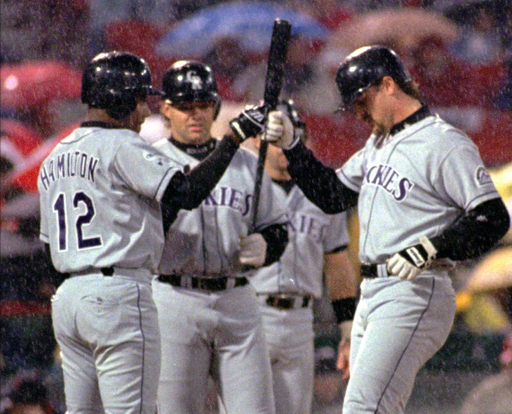 . Colorado Rockies Larry Walker, right, is congratulated by teammates Darryl Hamilton, (12), and Dante Bichette as he crosses the plate after hitting his second 3-run homer of the night in the second inning against the St. Louis Cardinals Wednesday, April 28, 1999 at Busch Stadium in St. Louis. The two home runs were Walkers first of the season.(AP Photo/Leon Algee)