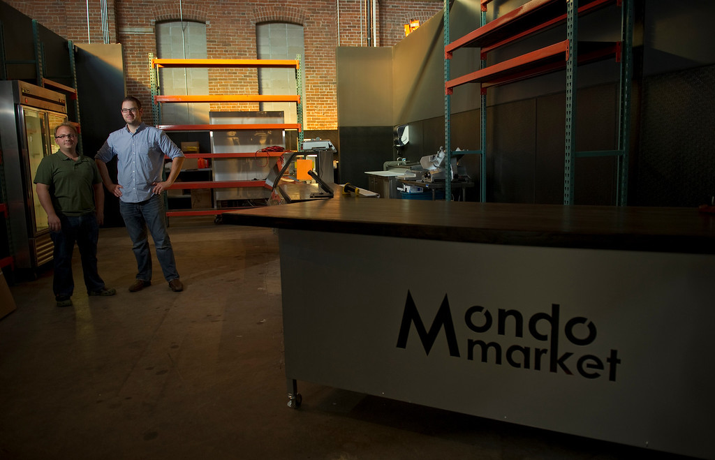 . The new inventive space in a former 19th century foundry,  The Source, 3350 Brighton Blvd. in Denver, is beginning to open. Nicolas Farrell,left, and Michael Davis in their soon to open Mondo Market on Monday August 26, 2013.  Mondo Market began as an e-commerce business that is now opening it\'s first retail space. (Photo By Cyrus McCrimmon/The Denver Post )