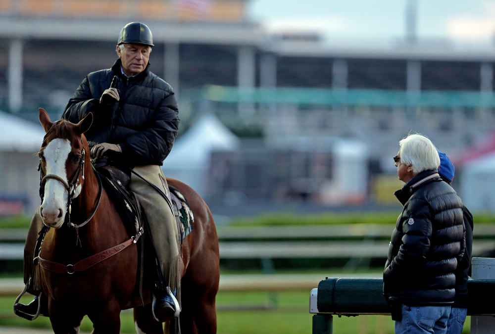 . Trainers D. Wayne Lukas, left, and Bob Baffert talk during morning workouts at Churchill Downs Thursday, May 1, 2014, in Louisville, Ky. (AP Photo/Charlie Riedel)
