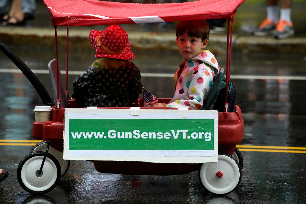 ". Kayla Rice/Reformer Alice and Ethan Braden ride in a wagon with the ""Gun Sense Vermont\"" group in the Brattleboro Fourth of July parade on Friday."