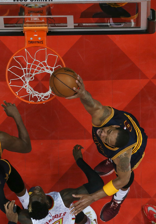 . Cleveland Cavaliers forward Channing Frye (9) scores as Atlanta Hawks guard Dennis Schroder (17) defends in of Game 3 of the second-round NBA basketball playoff series, Friday, May 6, 2016, in Atlanta. Cleveland won 121-108 and leads the best-of-seven series 3-0. (AP Photo/John Bazemore)