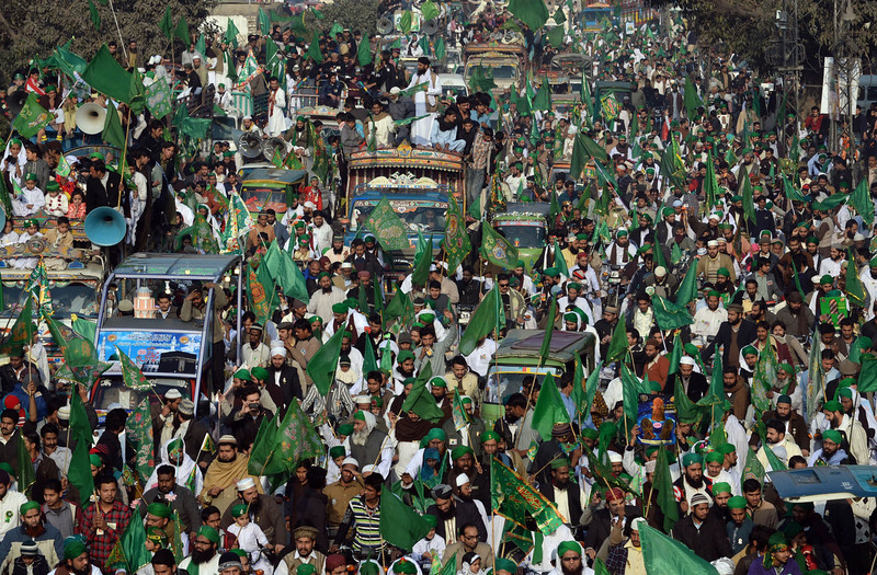 . Pakistani Muslims march during celebrations marking Eid Milad-un-Nabi, the birthday of Prophet Mohammed, in Lahore on January 14, 2014. Muslims across the world celebrate the birth of the Prophet Mohammed on 12 Rabil ul Awal, a month of the Muslim calendar. AFP PHOTO/Arif ALIArif Ali/AFP/Getty Images