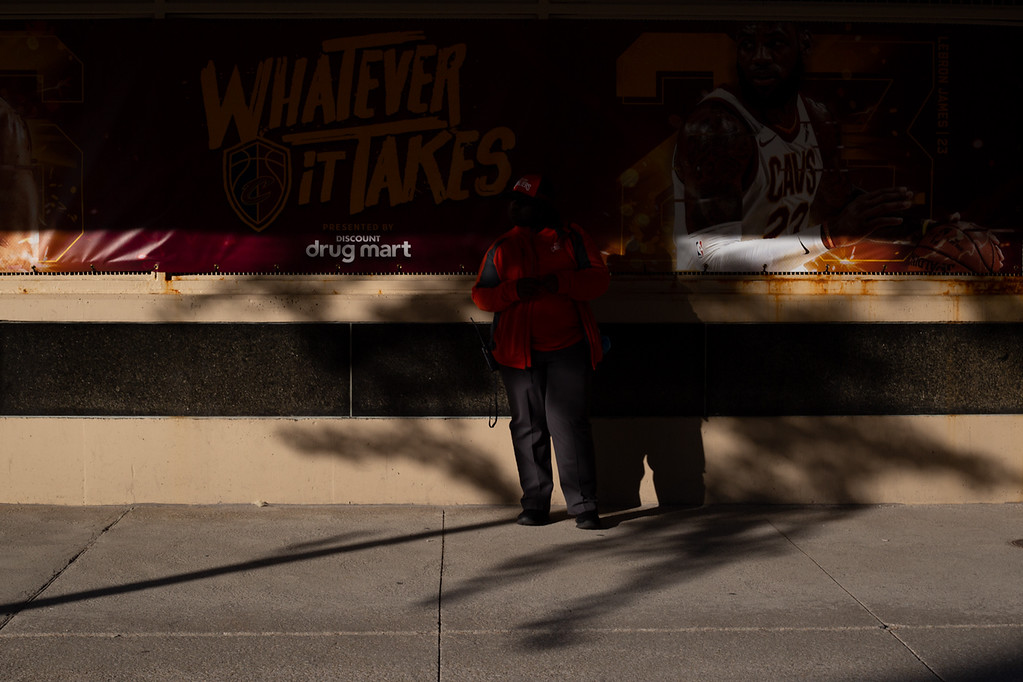 . Michael Johnson - The News-Herald A Cavaliers employee stands in evening light outside of the Quicken Loans Arena on May 23, 2018.