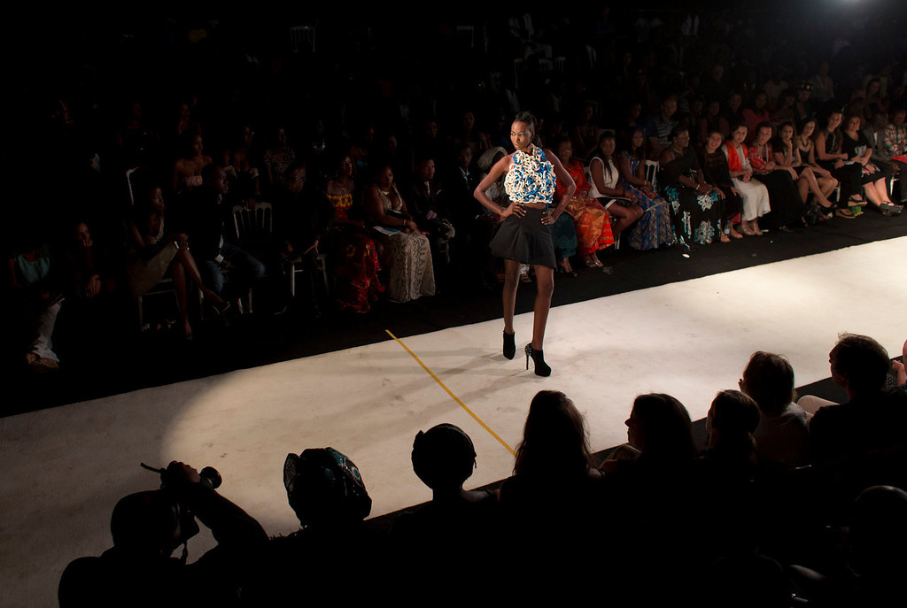 . A model displays a design by Carol Barreto of Brazil, during the final runway show of Dakar Fashion Week, at Hotel des Almadies, in Dakar, Senegal, in the early morning hours of Sunday, June 23, 2013. After a Friday runway show held in a dusty marketplace in the working class suburb of Guediawaye, Dakar Fashion Week closed Saturday night with a finale at a luxury hotel that showcased the work of 14 designers from West Africa, Europe, South America, and the Carribean.(AP Photo/Rebecca Blackwell)